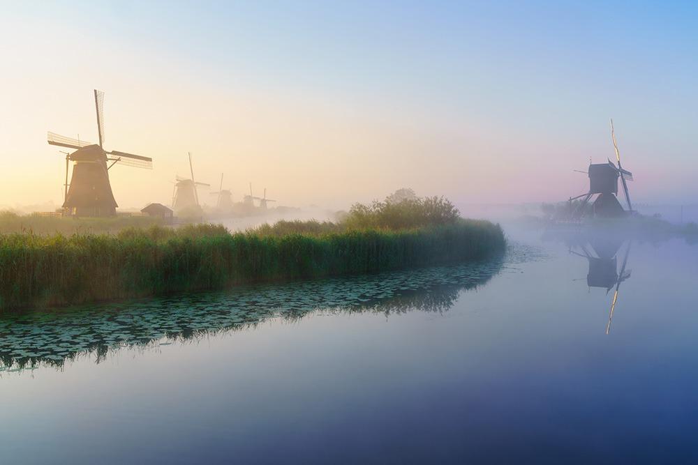 Kinderdijk sunrise with fog